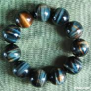 Blue & Gold Tiger Eye Carved Crystal Bracelet  border=